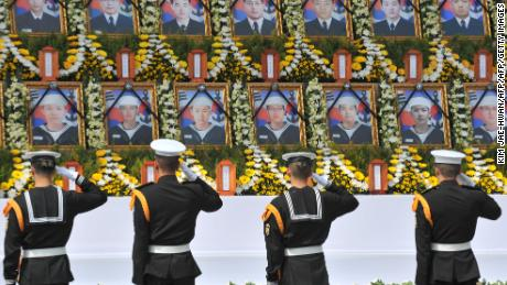 South Korean sailors salute images of their fallen comrades during a Cheonan memorial service in Seoul, April 25, 2010.
