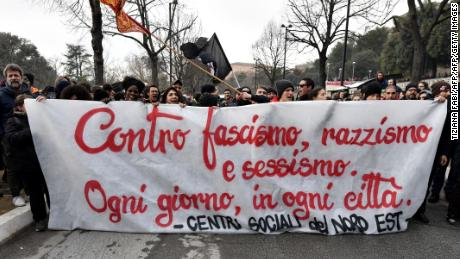 "Protesters hold a banner reading ""Against fascism, racism and sexism, everyday, in all cities'' during a demonstration in Macerata on February 10."
