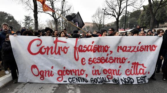 "Italian demonstrators hold a banner reading ""against fascism, racism and sexism."" Right wing, anti immigrant parties recently took power in Italy."