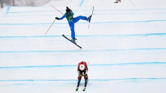 Phelan leads a quarterfinal race as Italy's Debora Pixner crashes.