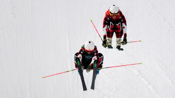 Phelan, left, and Serwa compete in the ski cross final.