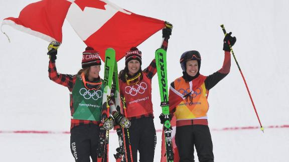 From left, Canadians Brittany Phelan and Kelsey Serwa celebrate on the podium with Switzerland's Fanny Smith. Serwa had just won gold in the ski cross. Phelan won the silver, and Smith finished with the bronze.