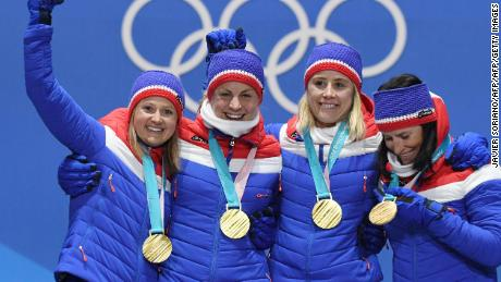 TOPSHOT - Norway's gold medallists Ingvild Flugstad Oestberg, Astrid Uhrenholdt Jacobsen, Ragnhild Haga and Marit Bjeorgen pose on the podium during the medal ceremony for the cross country women's 4x5km relay at the Pyeongchang Medals Plaza during the Pyeongchang 2018 Winter Olympic Games in Pyeongchang on February 18, 2018. / AFP PHOTO / JAVIER SORIANO        (Photo credit should read JAVIER SORIANO/AFP/Getty Images)