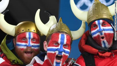 Norway fans pose prior to the men's 20km individual biathlon event during the Pyeongchang 2018 Winter Olympic Games on February 15, 2018, in Pyeongchang. / AFP PHOTO / Christof STACHE        (Photo credit should read CHRISTOF STACHE/AFP/Getty Images)