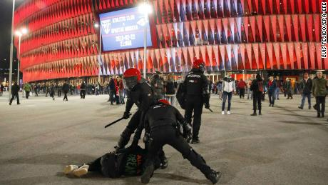 epa06555015 Police officers detain a man during riots prior to the UEFA Europa League round of 32, second leg soccer match between Athletic Bilbao and Spartak Moscow at San Mames stadium in Bilbao, Spain, 22 February 2018.  EPA-EFE/LUIS TEJIDO