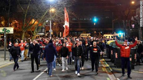 Spartak Moscow supporters march and shout on their way to the stadium.