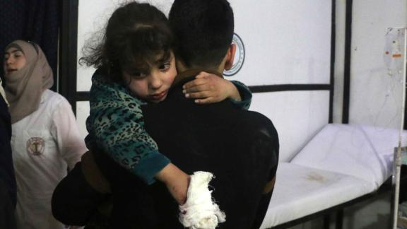 A wounded girl is carried  in Douma, Eastern Ghouta.