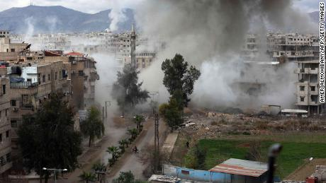Smoke billows following Syrian government bombardments on Kafr Batna, in the besieged region of Eastern Ghouta.