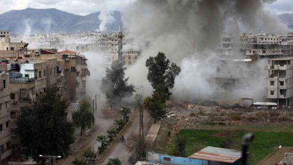 Smoke billows following strikes on Kafr Batna, in the Eastern Ghouta region, on Thursday.