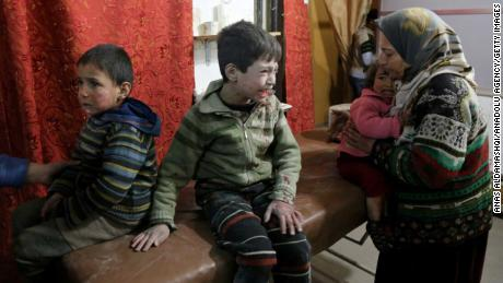 Inujured Syrian children cry as they wait to receive medical treatment at a field hospital after strikes on Kafr Batna in Eastern Ghouta on Thursday.