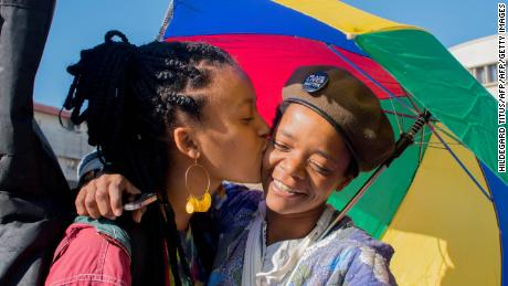 Dozens of people cheer and dance as they take part in the Namibian Lesbians, Gay, Bisexual and Transexual (LGBT) community pride Parade in the streets of the Namibian Capitol on July 29, 2017 in Windhoek. Even though there have been marches and protests against discrimination against the LGBT community in the past years, this is the first time that the community held such a parade along the capital's main street, Independence Avenue, to celebrate their identity and rights.