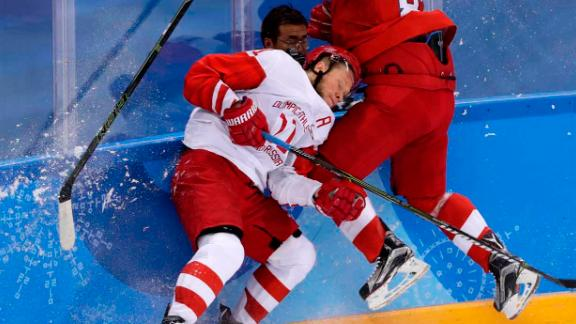 Russia's Sergei Andronov, left, collides with Jakub Nakladal of the Czech Republic during a semifinal hockey game. The Russian athletes won 3-0 to advance to the final.