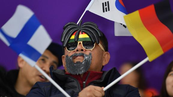 A spectator gets into the spirit of the Games during the 1,000-meter speedskating event.