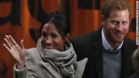 (FILES) This file photo taken on January 09, 2018 shows Britain's Prince Harry and his fiancée US actress Meghan Markle arriving for their visit to Reprezent 107.3FM community radio station in Brixton, south west London on January 9, 2018.   The leader of the UK Independence Party (UKIP) faced calls to resign on January 14, 2018 after his girlfriend reportedly made racist remarks about Prince Harry's fiancee Meghan Markle. Henry Bolton, who was elected in September, said his 25-year-old partner Jo Marney had been suspended from the anti-EU, anti-immigration party after the text messages were published in the Mail on Sunday newspaper. / AFP PHOTO / Adrian DENNISADRIAN DENNIS/AFP/Getty Images