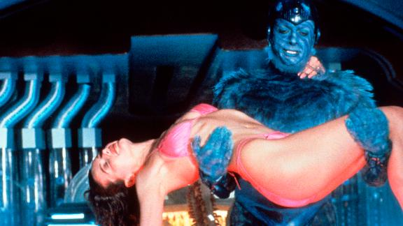 """<strong>""""Earth Girls Are Easy""""</strong>: A bikini clad Geena Davis is carried by Jeff Goldblum in this comedy about a Southern California woman who befriends three furry aliens after their ship lands in her swimming pool. <strong> (Amazon Prime, Hulu) </strong>"""