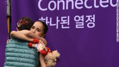 Alina Zagitova (right) hugs Evgenia Medvedeva after the scores are announced.