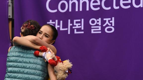 Alina Zagitova (right) hugs Evgenia Medvedeva after the scores are announced.