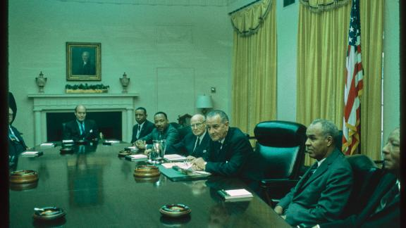 This photograph of President Lyndon B. Johnson meeting in the Cabinet Room was taken by James P. Blair on April 28, 1966. President Johnson met that day with Civil Rights leaders, including Dr. Martin Luther King, Jr., and members of Congress and his Cabinet to discuss and sign his Special Message to the Congress Proposing Further Legislation To Strengthen Civil Rights. Johnson's Special Message called for the enactment of federal law prohibiting discrimination based on race, religion, or national origin. Johnson would go on to send a Special Message to Congress every year until the April 11, 1968 signing of the Civil Rights Act of 1968. Seated from left to right are: Andrew J. Biemiller of the AFL-CIO; Attorney General Nicholas deB. Katzenbach; Floyd B. McKissick, national director of the Congress of Racial Equality; Dr. King; Rep. Emanuel Celler of New York; President Johnson; Roy Wilkins, executive director of the NAACP; and Civil Rights and union labor leader A. Philip Randolph.