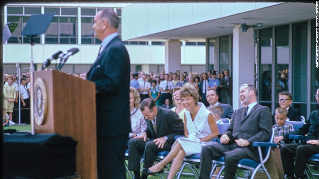 This photograph by Joseph J. Scherschel shows scenes from President Lyndon B. Johnsons visit to NASAs Manned Spaceflight Center in Houston, Texas. The purpose of the visit was a speech to honor the crew of the Gemini 4 mission and Johnson nominated astronauts James McDivitt and Edward White for promotion to the rank of lieutenant colonel. The Gemini 4 mission spanned four days and 62 Earth orbits, and included the first American spacewalk. Here, Johnson is delivering his remarks.The Manned Spaceflight Center was established in 1961 where it served the Mission Control Center for NASAs spaceflight program and led the Gemini, Apollo, and Skylab missions. In 1973, it was renamed the Lyndon B. Johnson Space Center in honor of the former president whose home state was Texas. Today, the center continues to serve as Mission Control and leads NASAs International Space Station operations.