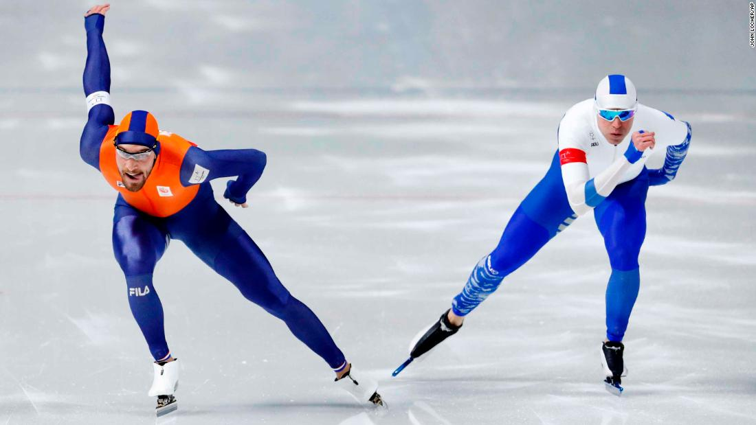Dutch speedskater Kjeld Nuis, left, races next to Finland's Mika Poutala in the 1,000 meters. Nuis won the gold, his second of the Games.