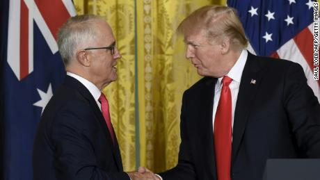 US President Donald Trump and Australian Prime Minister Malcolm Turnbull (L) shake hands durring a joint press conference in the East Room of the White House in Washington, DC, February 23, 2018.