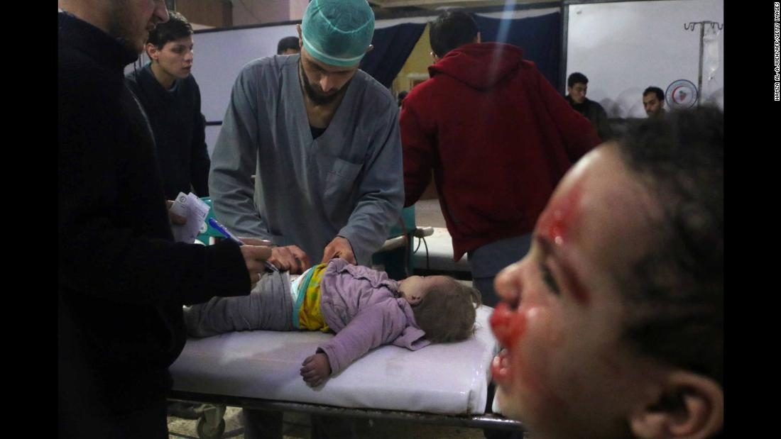 "Medics tend to a baby as a child cries next to them at a makeshift clinic in Douma, Syria, on Thursday, February 23. <a href=""https://www.cnn.com/2018/02/23/middleeast/syria-eastern-ghouta-bombardment-fire-rockets-intl/index.html"" target=""_blank"">More than 400 civilians have been killed</a> this week in Syria's rebel-held Eastern Ghouta region, according to the head of the region's health department on Friday, February 23. Syrian regime forces have been pounding Eastern Ghouta with shells, mortars and bombs."