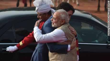 India's Prime Minister Narendra Modi (R) embraces Canada's Prime Minister Justin Trudeau (C) during a ceremonial reception at the Presidential Palace in New Delhi on February 23, 2018.
