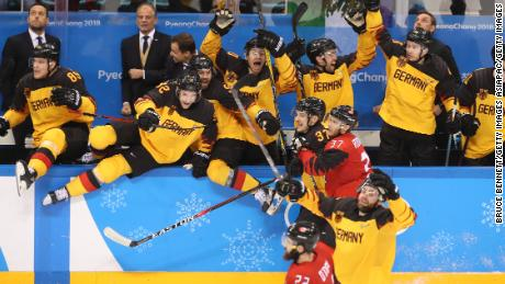 Germany celebrate defeating Canada 4-3 in the semifinals