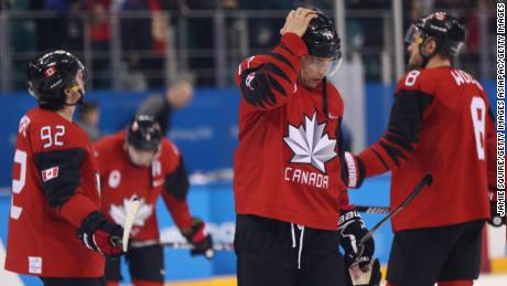 Canada players react after losing 4-3 to Germany during the ice hockey semifinals at PyeongChang 2018.