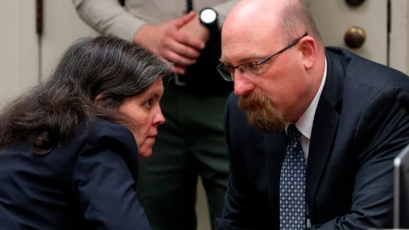 Louise Turpin talks with attorney Jeff Moore during Friday