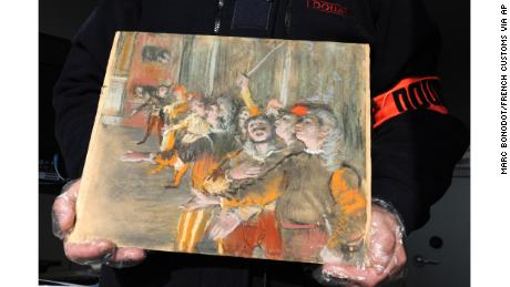 This photo taken Thursday Feb. 22, 2018 and provided by French Customs shows a stolen painting by French painter Edgar Degas. French customs have discovered an original Impressionist masterpiece by Edgar Degas stolen in 2009 _ in a suitcase on a bus. (Marc Bonodot/French Customs via AP)