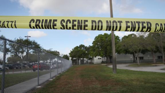 PARKLAND, FL - FEBRUARY 23:  Crime scene tape is seen outside Marjory Stoneman Douglas High School as teachers and staff are allowed to return to the school for the first time since the mass shooting on campus on February 23, 2018 in Parkland, Florida. Police arrested 19-year-old former student Nikolas Cruz for killing 17 people at the high school.  (Photo by Joe Raedle/Getty Images)