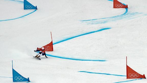Slovenia's GloriaKotnik races down the course for the parallel giant slalom.