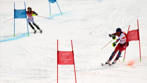 Switzerland's Ramon Zenhaeusern, right, leads Germany's Alexander Schmid as they race during the team skiing event. The Swiss team would go on to win the gold.