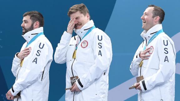 US curler Matt Hamilton, center, cries during the medal ceremony.