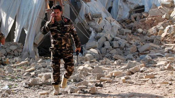 Security forces inspect the site of a blast in Lashkar Gah, capital of Helmand province, on Saturday.