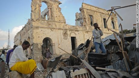 Residents survey remains after the Friday bombings in Mogadishu.