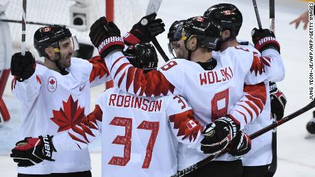Canada's Wojciech Wolski  (second right) celebrates scoring in the men's bronze medal ice hockey match between the Czech Republic and Canada at the Gangneung Hockey Centre in Pyeongchang.