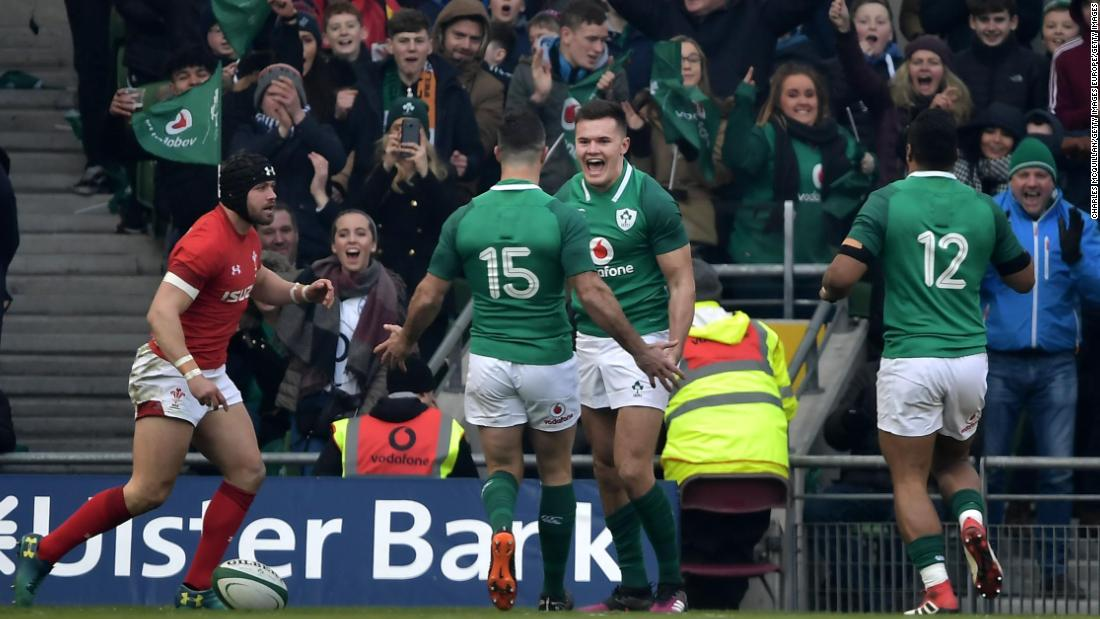 Jacob Stockdale celebrates with teammates after scoring an early try against  Wales in Dublin.