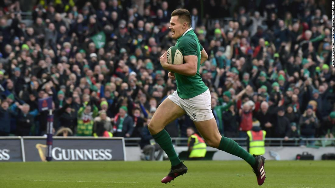 Jacob Stockdale scores his decisive second try to seal Ireland's 37-27 victory over Wales in Dublin.
