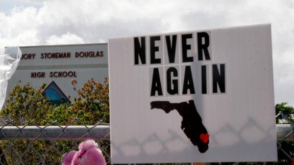 Memorials are seen on a fence surrounding Marjory Stoneman Douglas High School in Parkland, Florida on February 21, 2018.  A former student, Nikolas Cruz, opened fire at Marjory Stoneman Douglas High School leaving 17 people dead and 15 injured on February 14. / AFP PHOTO / RHONA WISE        (Photo credit should read RHONA WISE/AFP/Getty Images)