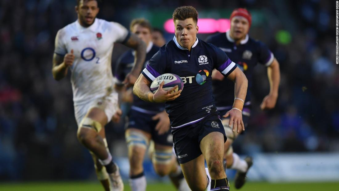 Huw Jones breaks clear again to score his second try and Scotland's third of the opening half against England.