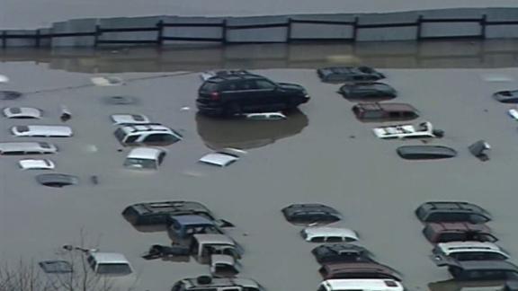 Floodwaters swallowed cars in Louisville, Kentucky, on February 24.