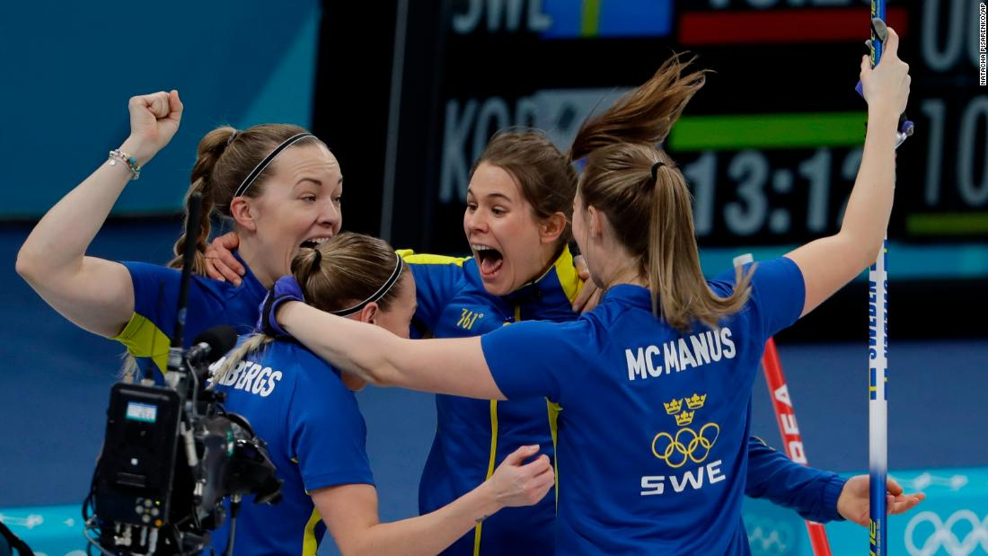 The Swedish women's curling team celebrates its win over South Korea in the gold-medal game.