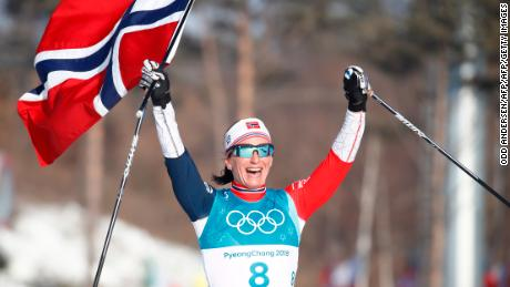 Norway's Marit Bjoergen celebrates after winning the women's 30km cross country mass start.