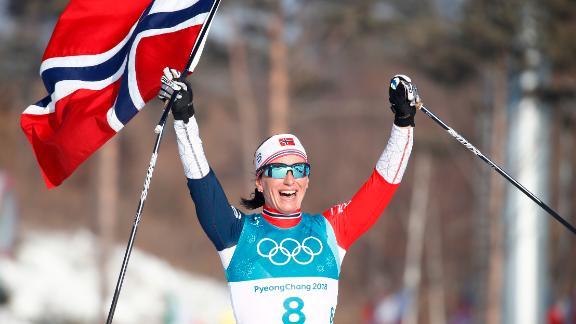 Norway's Marit Bjoergen celebrates after winning the women's 30km cross-country mass start.