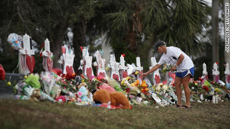 Police, flowers and media greet Stoneman Douglas students as they return to school