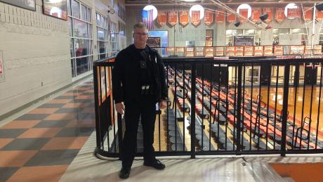 Officer Chris Bryant makes the rounds at Hoover High School, where he has worked for 12 years.