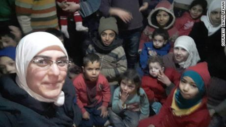 Bayan Rehan, the author of this article, with children in one of Eastern Ghouta's basements.