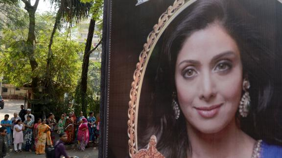 A picture of Bollywood actress Sridevi Kapoor is seen put up outside her residence in Mumbai on February 26, 2018, following her death.  Heartbroken fans on February 26 awaited the arrival of the body of Bollywood superstar Sridevi Kapoor as tributes poured in for the actress who died in Dubai of a heart attack aged just 54. / AFP PHOTO / PUNIT PARANJPE        (Photo credit should read PUNIT PARANJPE/AFP/Getty Images)